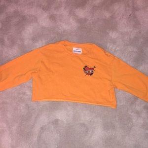 Bright orange cropped sweatshirt